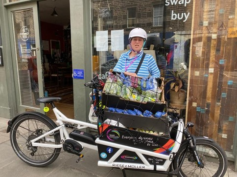 photo of Cathy next to a packed cargo bike